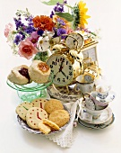 Tea Time Items with Clocks and Pastries