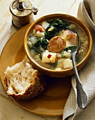 Hearty Potato, Sausage and Kale Soup; Piece of Crusty Bread