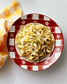 Fettuccini with an Herb Cheese Sauce in a Bowl; From Above