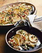 Scalloped Potatoes with Peas and Bacon in Serving Dish and Bowl