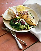 Grilled Chicken Breast with Salad and a Piece of Crusty Bread