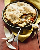 Chicken Pot Pie with Crust Partially Removed to Show Filling; Spoon