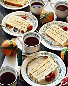 Servings of Layered Almond Cake with Cups of Coffee; Holiday Dessert