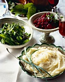 Side Dishes on Buffet Table; Mashed Potatoes, Snow Peas, Cranberry Sauce