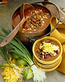 Beef Chili in a Large Copper Pot and Serving Bowl; Large Wooden Scoop
