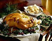 Roast Stuffed Turkey on a Platter; Side Dishes