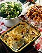 Three Side Dishes in Serving Bowls; Broccoli, Sweet Potatoes and Potatoes