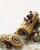 Partially Sliced Buche De Noelle; Christmas Log Cake