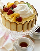 Milano Cookie Custard Cake Topped with Fruit and Whipped Cream; Tea