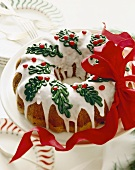 Christmas Bundt Cake with Icing and Holly Decorations; Ribbon