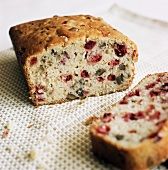 Cranberry and walnut bread, partly sliced