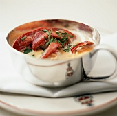 Lobster Bisque (lobster soup) in silver cup