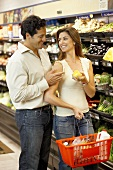 Smiling couple shopping in a supermarket