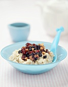 Porridge with dried fruit and cup of coffee