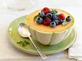 Fresh berries on cantaloupe melon half