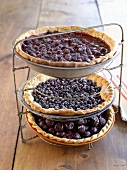 Three different fruit tarts on tiered stand (USA)