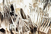 Many silver knives and forks (full-frame)