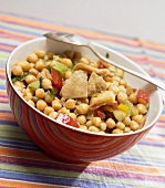 Chick-pea salad in bowl with spoon