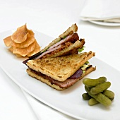 Grilled Ham Sandwich, BLT, On a Plate with Pickles and Chips