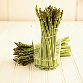 Asparagus Bundle in a Glass with Water with Bundle of Asparagus Next to Glass
