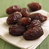 Dried dates on fabric napkin