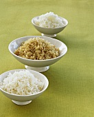 Three different kinds of rice in separate bowls