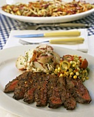 Sliced beef steak with potatoes and sweetcorn salad
