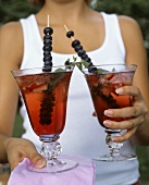 Two summery drinks with berries