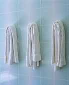 Three white bath towels