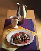 Auberginenterrine mit Couscous, Pancetta, Portobello, Tomaten