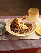 Chicken leg with gumbo and couscous