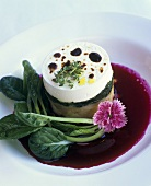 Goat's cheese and spinach cake on beetroot sauce