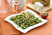 Chicken and Green Bean Salad with Sliced Almonds on a White Plate, Small Bowl of Sliced Almonds