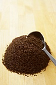 Pile of Ground Coffee with Coffee Scoop