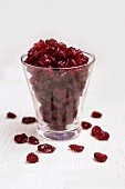 Dried Cranberries in and Beside a Glass