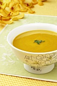 Bowl of Butternut Squash Soup with Chopped Chive Garnish