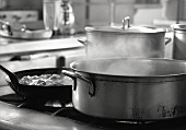 Stockpots Steaming on a Commerical Kitchen Stove