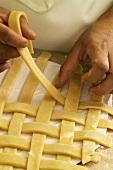 Hands Making a Lattice Pie Crust