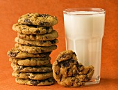 A Stack of Chocolate Chip Cookies with a Glass of Milk