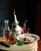 Moroccan Tea Scene, Sweet Moroccan Mint Tea in Moroccan Glasses, Tae Pot and Sugar Cubes
