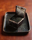 Small Antique Tin Canister of Loose Oolong Tea on a Tray