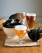 Two Glasses of Lambic Beer with a Bowl of Steamed Mussels, Thyme and Bread