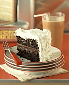 A Piece of Chocolate Cake with White Frosting