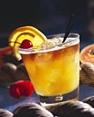 Rum Drink with Orange and Cherry Garnish