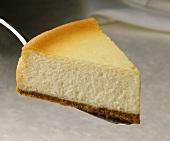Slice of cheesecake on cake server