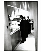 Waiters at a Buffet Station