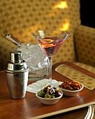 Cosmopolitan Martini; ice cubes; shaker; snacks