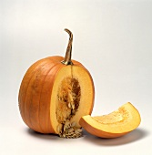 Two Pumpkins; One with a Piece Cut