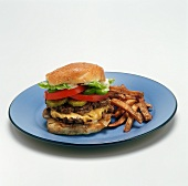 Double Cheeseburger and French Fries on a Blue plate