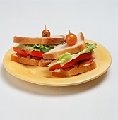 BLT Sandwich on White Bread; Halved